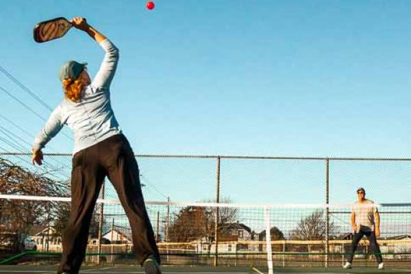Pickelball players enjoying culbertson park in downtown Long Beach