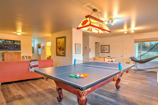 Photo of recreation room with pool table and ping pong table top