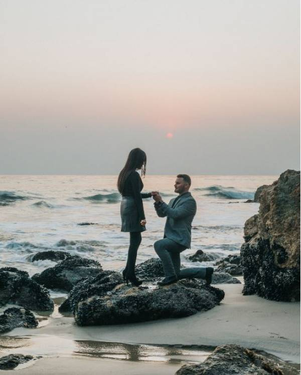 Proposing on the beach