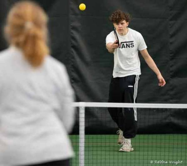 Teenager playing pickleball