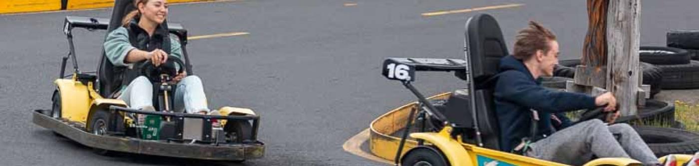 teenagers riding go karts in Long Beach, Washington