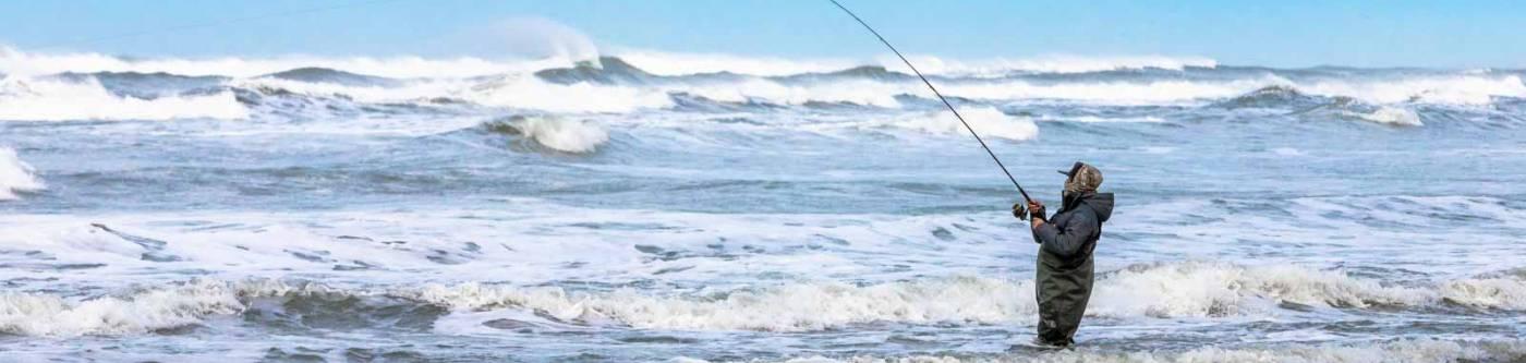 Woman surf fishing near Seaview Washington