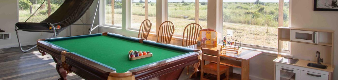 Game Room with pool table and arcade basketball